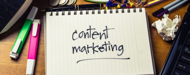 Handwritten note with the words content marketing on it showcase a business strategy
