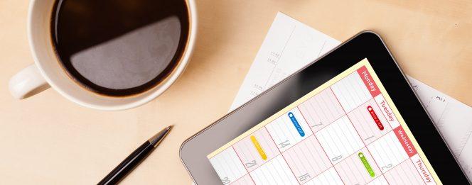 Coffee, Pen and Calendar on a desk guelph