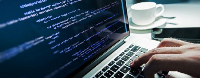 Laptop screen displays person learning web development skills online