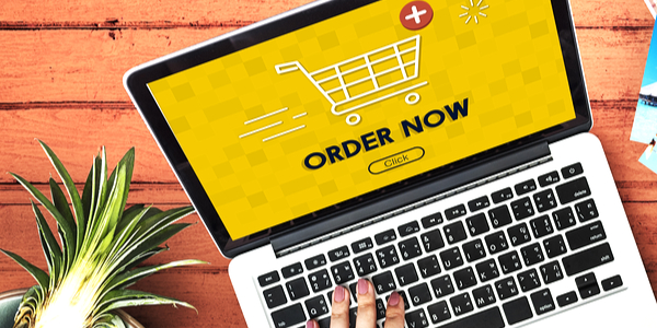 Laptop open and person shopping online