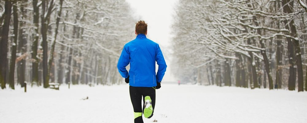 Man running in the cold decides to stay fit despite the pain